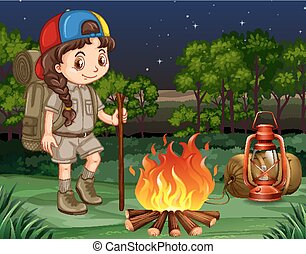 Little girl standing by the campfire