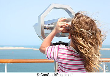 little girl standing on cruise liner deck and looking in binocular, half body, view from back