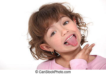 Little girl sticking tongue out