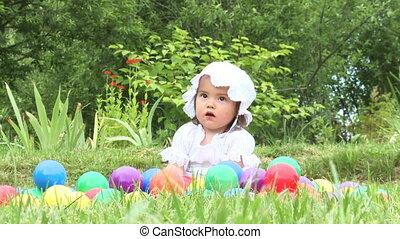 Little girl   - Little girl play with balls outdoors