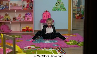Little Girl Stretching And Jump - Little caucasian white...