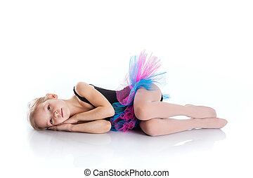 Little girl 5-7 years old lying on the floor