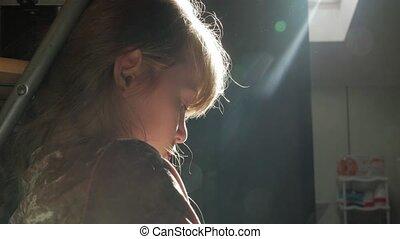 Little girl sunbeam backlight indoors