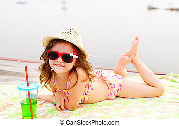 Little girl sunning at the pier