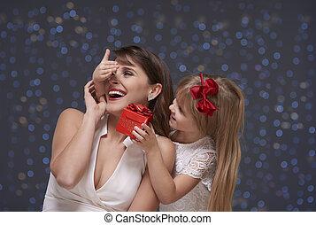 Little girl surprising her mom