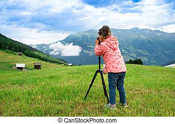 Little Girl Taking Photo Of Mountain Landscape