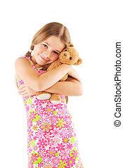 Little girl taking teddy bear