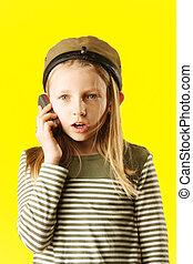 Little girl talking by phone