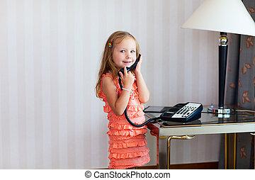 Little girl talking on phone