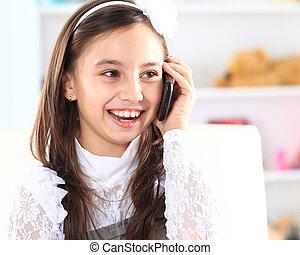 Little girl talking on the phone.