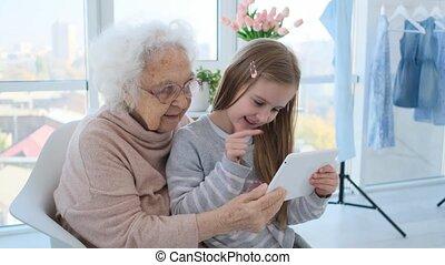 Little girl teaching grandmother