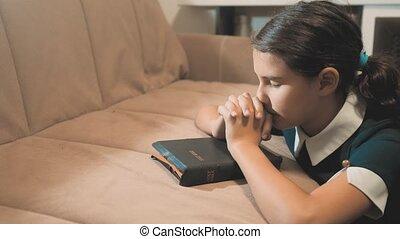 Little girl teenager praying in the night. Little girl hand...