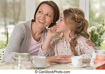 little girl telling a secret