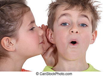 little girl telling his brother a secret
