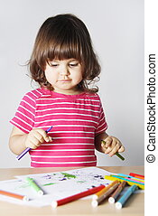 Little Girl Thinking What to Draw