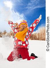Little girl throw snow