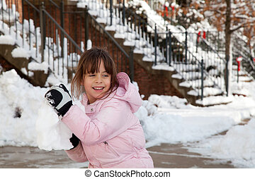 Little Girl Throwing a Giant Snow Ball