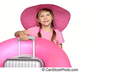Little girl tourist with travel suitcase showing thumb up sign