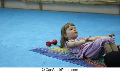 Little girl training at the gym
