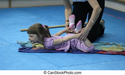 Little girl training at the gym wit