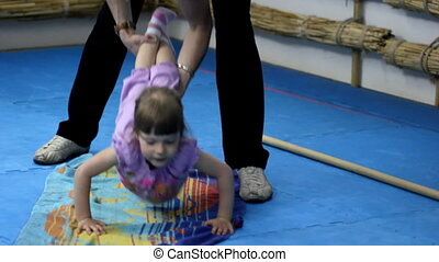 Little girl training at the gym, wr
