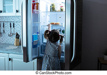 Little Girl Try To Take Muffins From Refrigerator