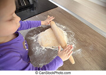 Little girl trying to cook