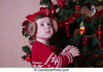 Little girl under Christmas tree