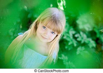 little girl under the trees