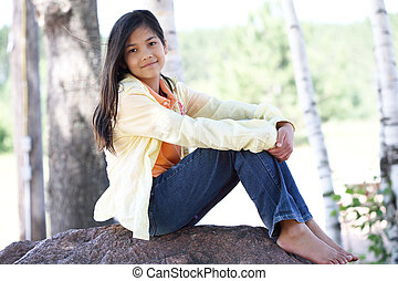 Little girl under trees,