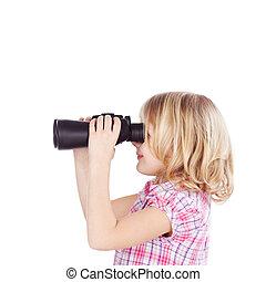Little girl using a pair of binoculars