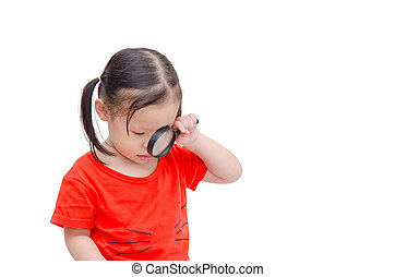 Little girl using magnifying glass