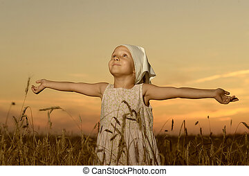 Little girl vilager in field
