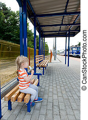 little girl waiting for the train