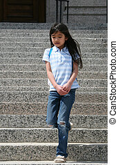 Little girl walking down granite steps outdoors, getting out...