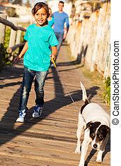 little girl walking her dog