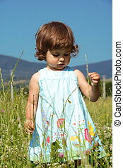 Little Girl Walking on Meadow
