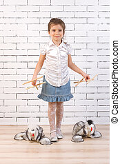 girl walking with a toy dog ??on the line