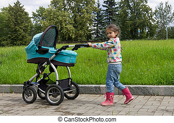 little girl walking with stroller