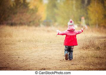 Little girl walking with windmill