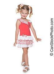Little girl walks against the white