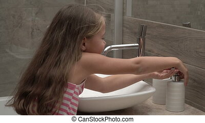girl washing hands in the bathroom