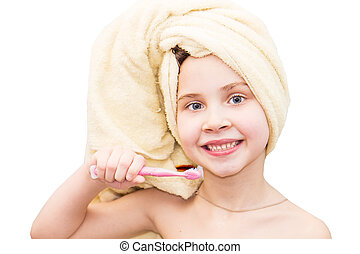 Little girl washing teeth after bath