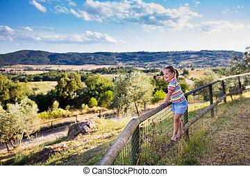 Little girl watching landscape in Italy - Happy little girl...