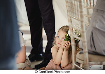 Little Girl Watching People at a Wedding - Little girl is...