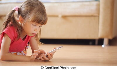 Little girl watching photos in smartphone