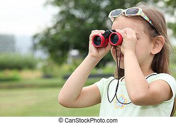 little girl watching through binoculars