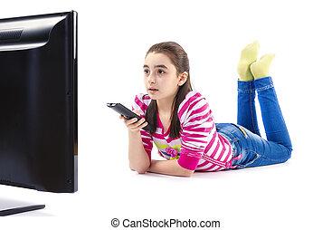 Little girl watching tv - Little girl watching LED tv laying...