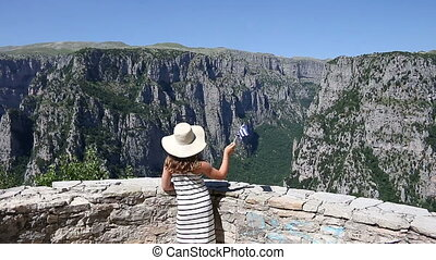 little girl waves with a Greek flag on Vikos gorge Zagoria