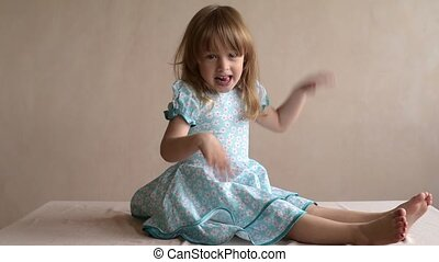 Little girl waving her hands